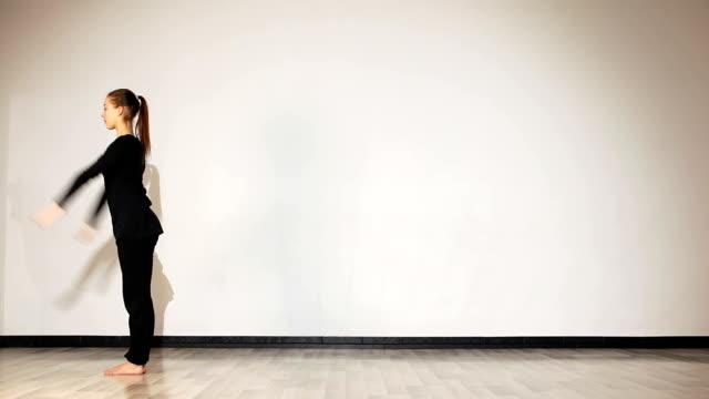 Gymnastic girl in black doing back flip video