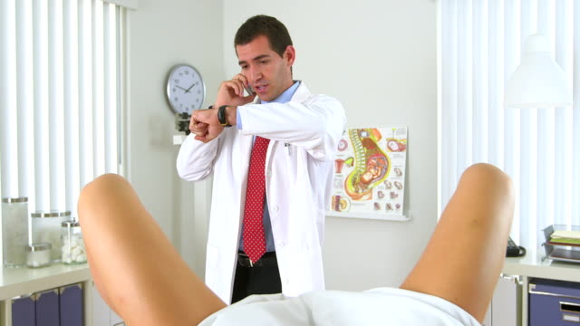 Gynecologist talking on the phone video