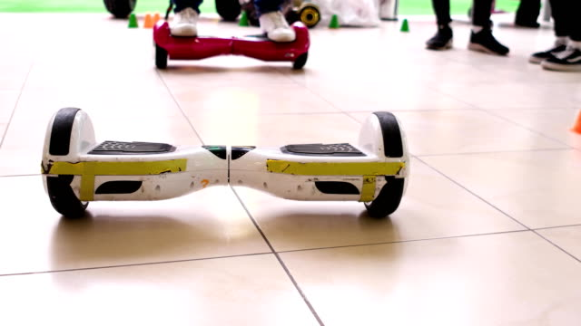 gyroscooter, a two-wheeled scooter, street electric vehicle, made in the form of transverse strips with two wheels on the sides - io księżyc filmów i materiałów b-roll