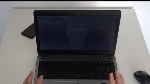 hacker creating an aritificial intelligence software on a laptop - rappresentazione umana video stock e b–roll