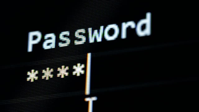 Hacker gets access, typing a password, close up.