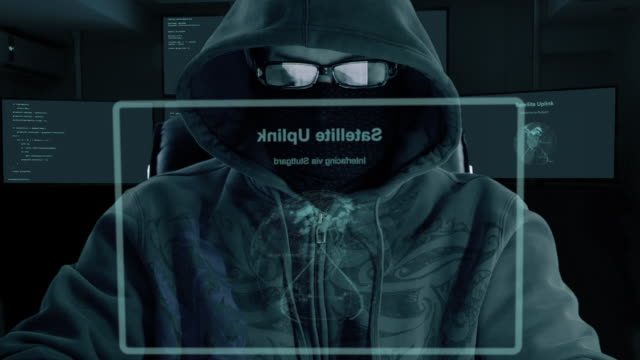 Hacker typing code. Night and low key. Close-up. Indoors night work. Programmer coding software of site. A hacker is preparing an attack on hacking portal. video
