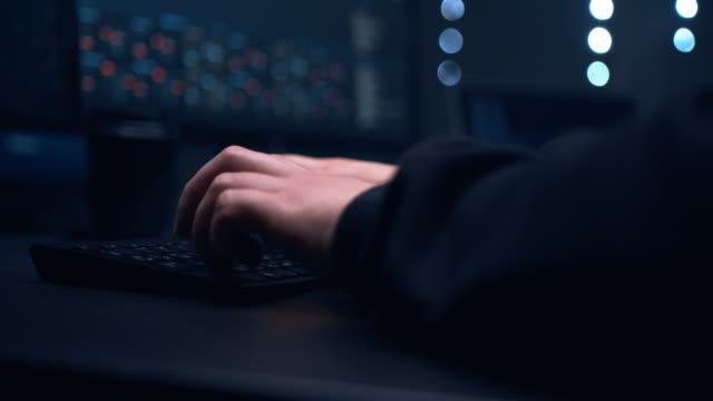 a hacker updates his security systems so that no government organization can track his online activities. - spyware filmów i materiałów b-roll