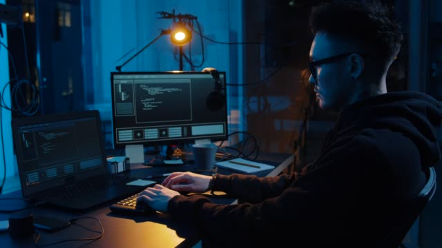 hacker using computer for cyber attack at night - spyware video stock e b–roll