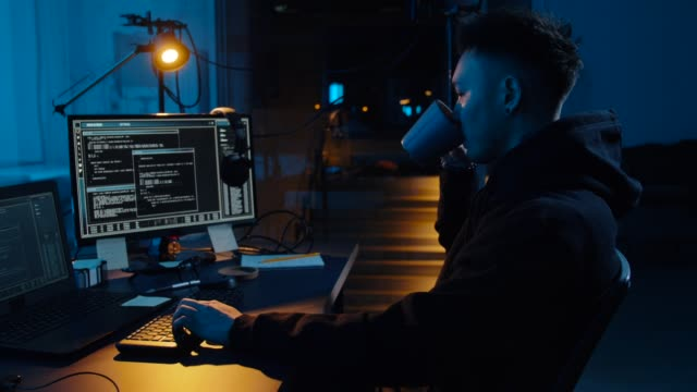 hacker using computer for cyber attack at night - crittografia video stock e b–roll
