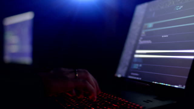 Hacker using laptop. Lots of digits on the computer screen. video