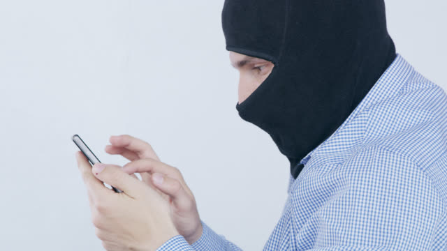 DS Hacker with balaclava stealing sensitive data video