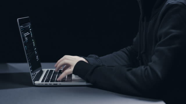 hacker with laptop - fraud stock videos & royalty-free footage