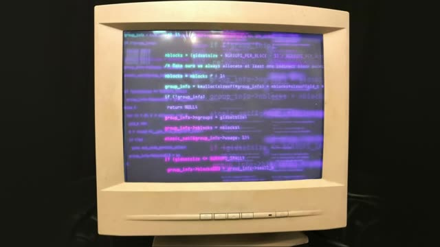 Hacking a vintage old vintage TV or computer monitor screen 80s 90s style. Glitches on screen monitor. Abstract source code data flow. Purple and blue text. screen noise. VHS style. Old kinescope