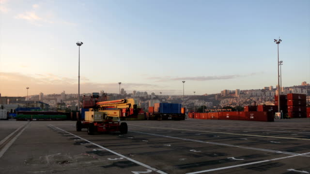 Haifa's busy harbor docks panoramic sunrise time lapse video