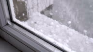 istock Hail Outside the Window. Pieces of hail fall on the windowsill behind a plastic window 1177631943