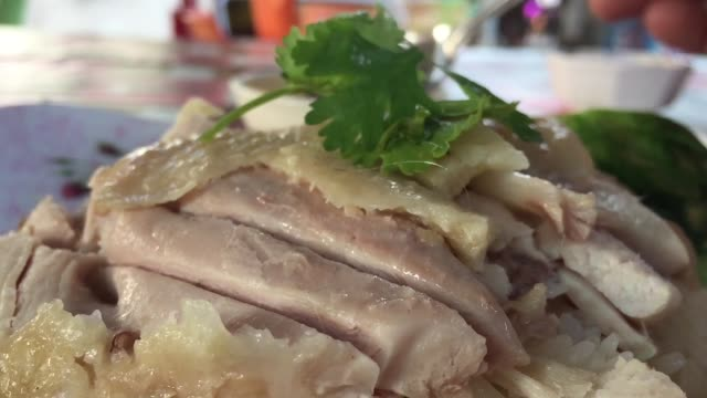 Hainanese chicken rice in plate