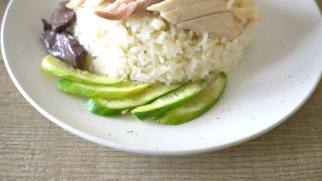 Hainanese chicken rice or steamed chicken rice Hainanese chicken rice or steamed chicken rice boiled stock videos & royalty-free footage