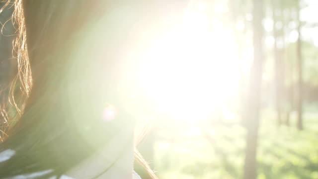 hair brunette girl develops wind at sunset video