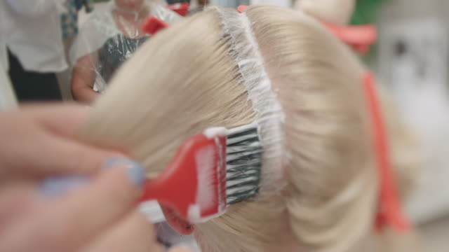 hair coloring. close up - bleach stock videos & royalty-free footage