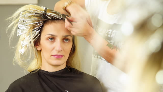Hair coloring. Close up Hair coloring. Close up beautician stock videos & royalty-free footage
