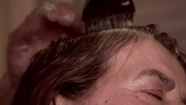 hårfärgning - mature women studio grey hair bildbanksvideor och videomaterial från bakom kulisserna