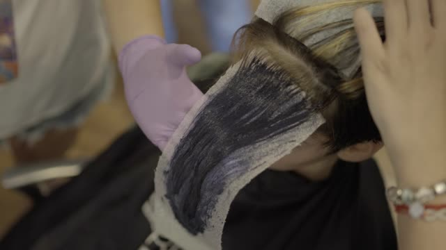 Hair dying Woman getting her hair dyed in the hair salon highlights hair stock videos & royalty-free footage