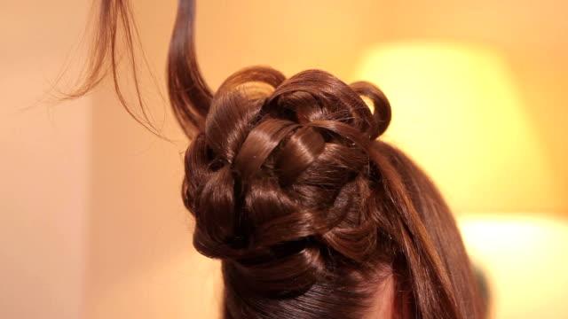 Hairdo. Beautiful brown hair make styling. video