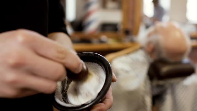 Hairstylist mixes shaving cream with brush video
