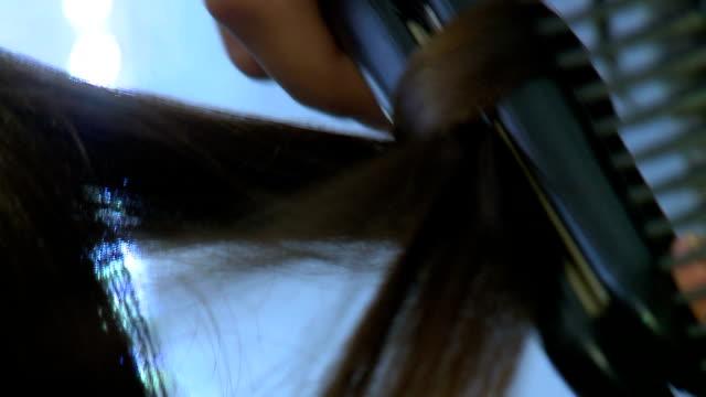 Hairstylist straightening hair video