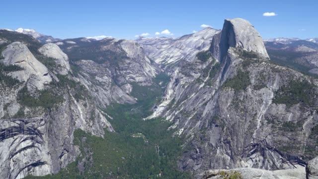 Half Dome behind granite walls in Yosemite