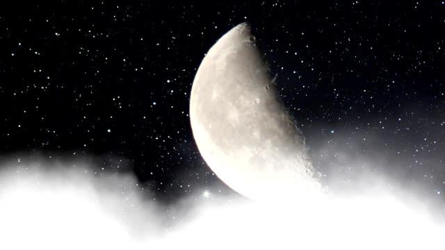 half moon on top of the clouds - halvmåne form bildbanksvideor och videomaterial från bakom kulisserna