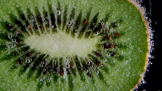 Half of kiwi in sparkling water video