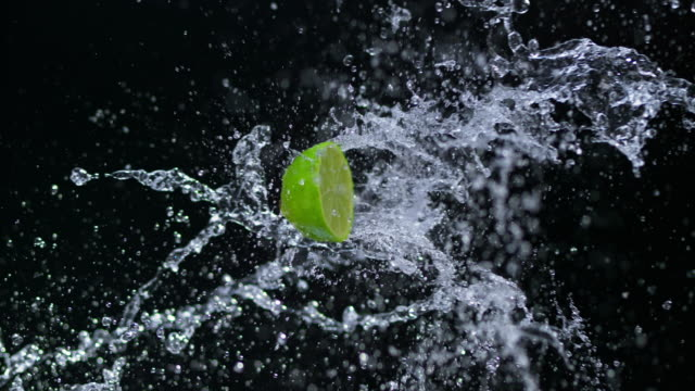SLO MO Half of lime hitting a water splash in the air video