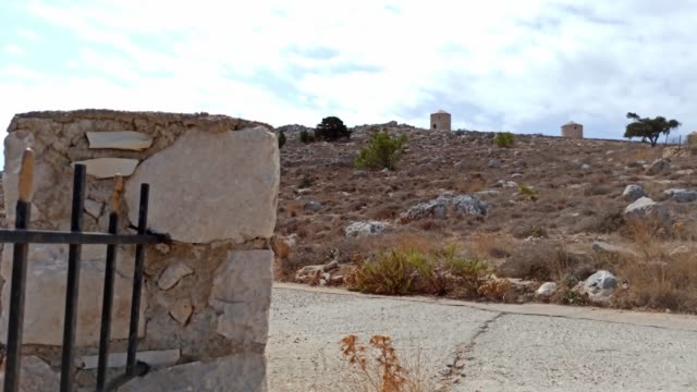 halki island in the aegean sea, pan shot of rustic rocky hilly island of halki (chalki) - isole egee video stock e b–roll