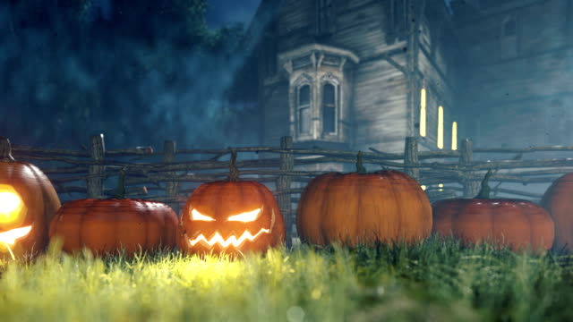 halloween background animation with the concept of creepy glowing pumpkins and old creepy mansion. - halloween background filmów i materiałów b-roll