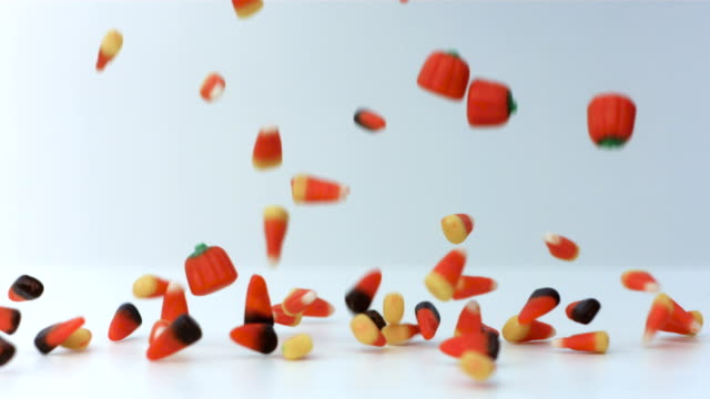halloween candy falling in slow motion on white background - halloween stock videos & royalty-free footage
