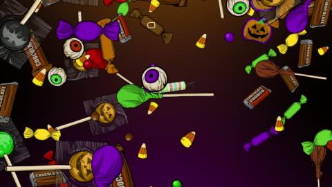 vídeos y material grabado en eventos de stock de halloween candy raining down - dulces