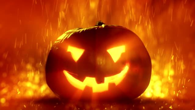 Halloween clip - demonic pumpkin with glowing light rays. video