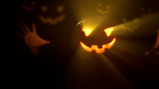 Halloween clip - scary pumpkin ghost with glowing light rays. video