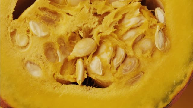 Halloween colorful hokkaido pumpkin - stop motion animation. Healthy vegetable raw food preparing - extreme close up view. Vibrant yellow transition b roll stock videos & royalty-free footage