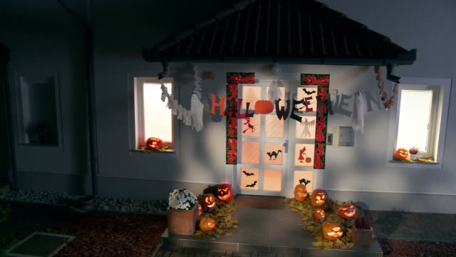 HD CRANE: Halloween Decorations Illuminated By Moonlight video