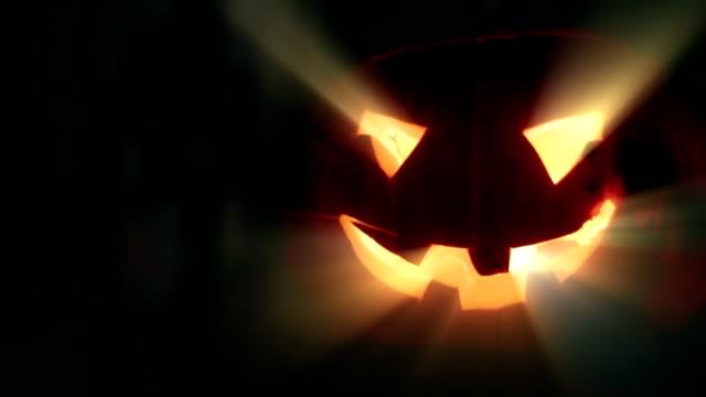 Halloween festival. Pumpkin in the window. video