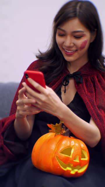 Halloween Girl Using Phone Sharing halloween covid stock videos & royalty-free footage