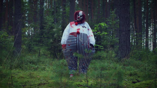4K Halloween Horror Clown in Forest Standing video