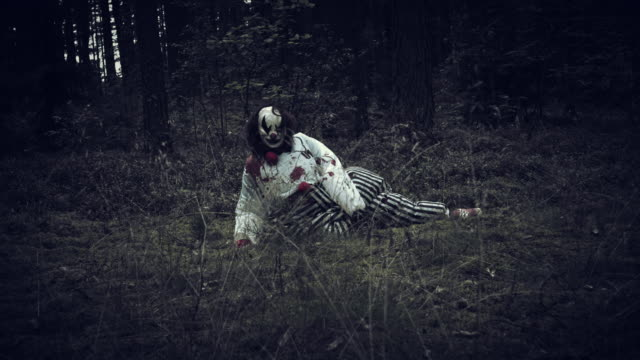 4K Halloween Horror Clown in Forest Waking Up video