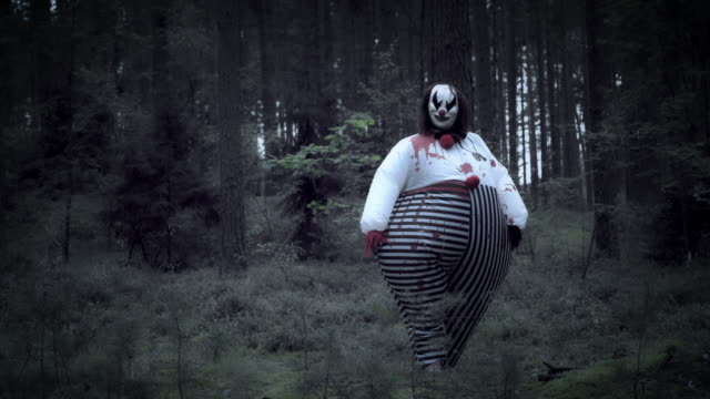 4K Halloween Horror Clown in Forest Walking video