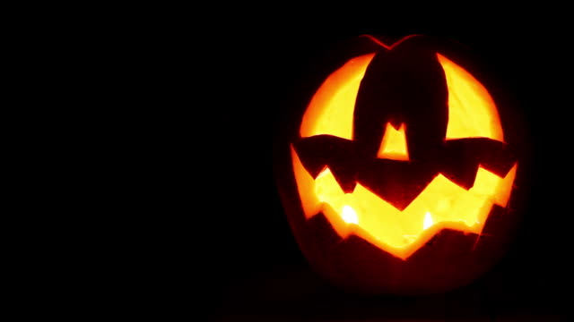 Halloween Jack-o'-lantern symbol face on the   black background