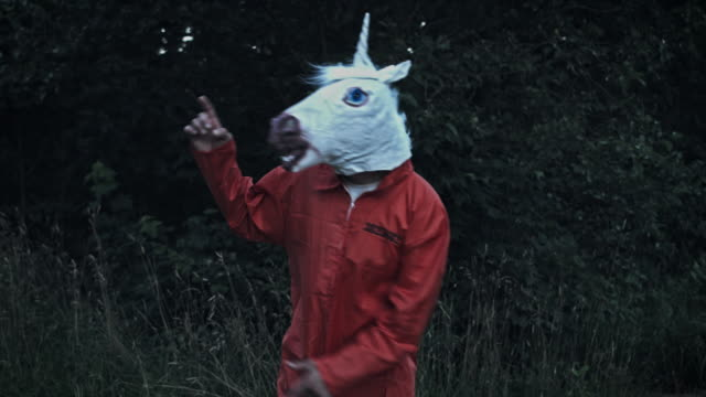 4K Halloween Man with Unicorn Horse Mask Dancing video