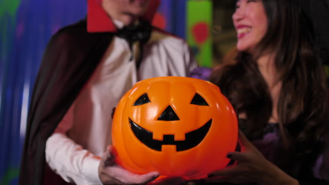 Halloween people show Jack-O-Lantern Pumpkin in Halloween party