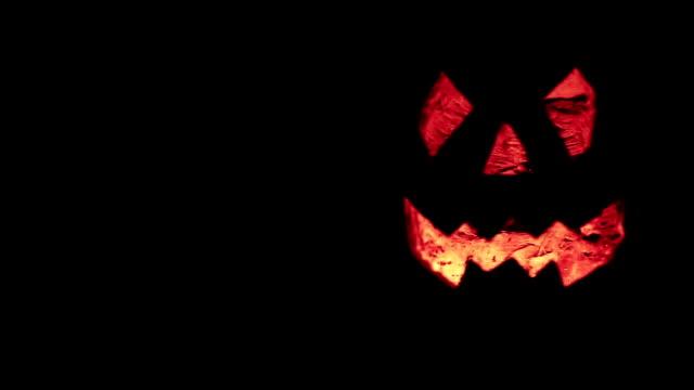 halloween pumpkin glow in the dark - pumpkin stock videos & royalty-free footage