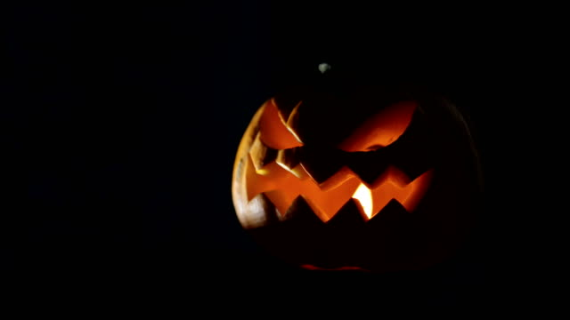 Halloween pumpkin Jack o lantern with candle lights at night