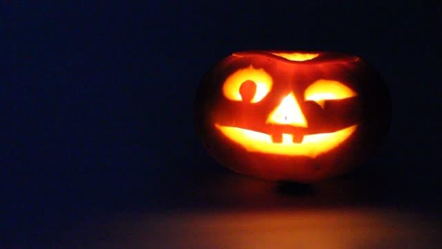 Halloween Pumpkin on white background. Jack lantern from juicy pumpkin. Burning candle.