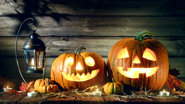 Halloween pumpkin Halloween pumpkin head jack-o-lantern on wooden background decoration stock videos & royalty-free footage