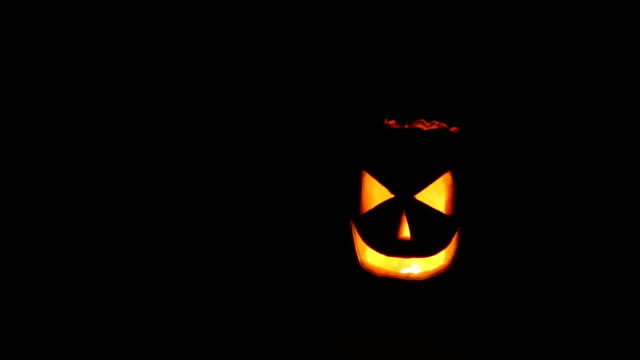 Halloween pumpkin with fire light Fred Jack video